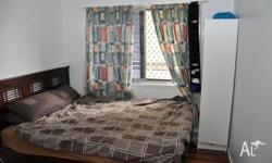 A small room in a furnished house is available in