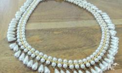 unique choker style pearl necklace. cash and pickup