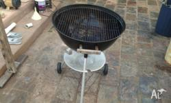 Black with wheels. Grill and water resistant lid, with