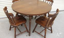 Round dining table with 4 timber chairs In reasonable