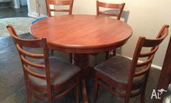 Excellent condition. Mahogany coloured timber round