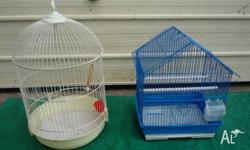 Round bird cage 50 cm tall and 32 cm in diameter. $