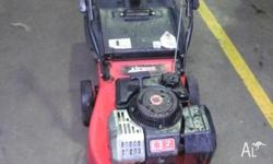 Used Rover 2-stroke push mower powered by a Suzuki