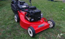 "A Rover Fairway push mower 18"" with a Briggs and"