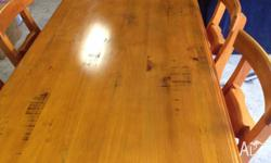 Rustic 7 piece dining setting in very good condition.