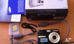 Samsung camera barely used Comes with memory card, box