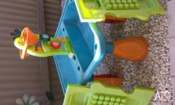 Sand and water play interactive station. Sun faded but