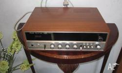 This is a 350A Sansui Solid State AM/FM Stereo Tuner