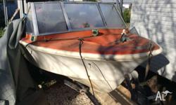 The hull is in good condition. Outboard is a Mercury