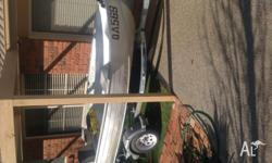 Trailer like new motor runs ok tinny in good condition.