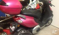 Pink scooter , with lockable carrier ,1 lady owner