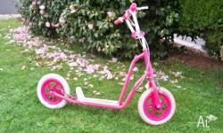 Pink scooter, inflatable tyres, front & rear brakes.