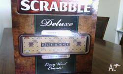 Scrabble Deluxe, Has a turntable , stronger tiles and