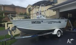 2011 40hp fuel and oil injected 70 hrs Boat and trailer