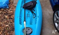 Blue open top sea kayak with paddle and attachable