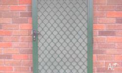 offered for sale is a security screen door with single