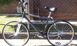 Sell new gray hybrid city bike/front suspension/ 700c