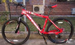 Sell new red alloy mountain bike/100% new condition