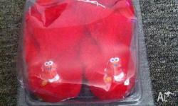 I am selling a pair of size 1 unisex, red Elmo slipper