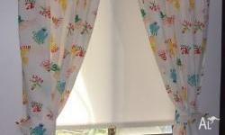 Pair of Sesame Street curtains. Comes with tie backs