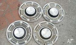 SET OF 4 FORD FALCON FAIRMONT HUB CAPS NOT SURE WHAT