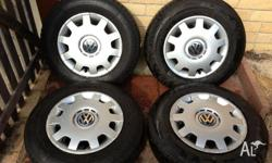 set of 4 wheels. Near new tyres in excellent condition