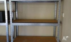 Metal frame with wood shelves. Ideal for garage