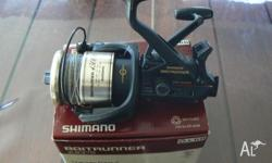 Shimano baitrunner 4500b with 30lb braid. great fishing