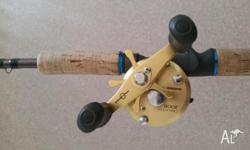 "Used Shimano 200B reel with Shimano T Series ""T Curve"