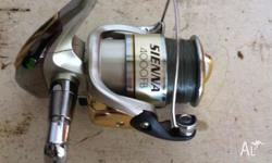Shimano sienna 4000 reel like new spooled up with 15 lb