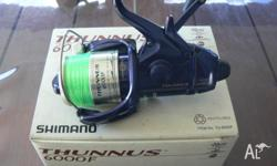 Shimano thunnus 6000F fishing reel with 20lb mono.