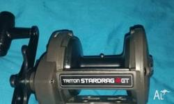 lightly used shimano triton 4gt reel, almost vintage