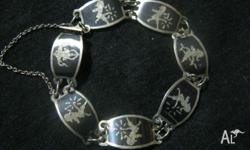 Siam silver hall marked 925 Braclet., with safety