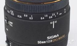 Sigma 50mm 2.8 macro lens with filter. Made by Sigma,