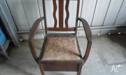 I HAVE FOR SALE A LOVELY SILKY OAK KOMODE CHAIR. COMES