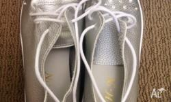 Silver lace up shoes with diamontes . Never worn, wrong
