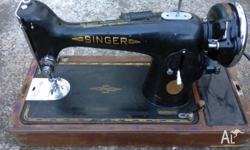Selling a rare Singer sewing machine As shown in the