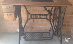 SINGER TREADLE SEWING MACHINE TABLE in solid order.