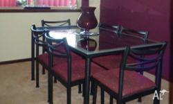 SOLID wrought iron and glass dining table with six