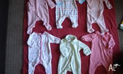 6 x Size 0000 Onesie suits - used. in good condition.