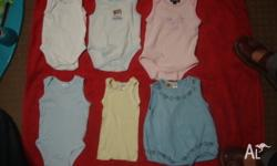 6 x Size 000 singlet bodysuits - used. In good