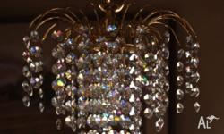 This is one of 3 matching crystal small chandeliers. It