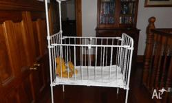 NOW REDUCED SHABBY CHIC OR ANTIQUE CAST IRON BASSINET