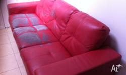Red 'Crystal' bonded leather sofa pair. 1 x 3 seater, 1