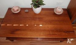 Solid Australian hard wood coffee table. Has one drawer