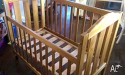 Nice solid Tasmanian oak cot with brass fittings and