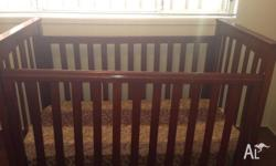 Solid Timber Baby Cot along with Mattress for sale for