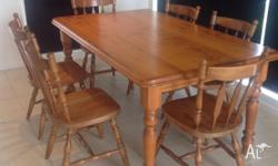 Solid, polished pine table and 6 matching chairs. Very