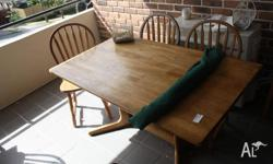 Solid wooden table with 5 chairs, good condition