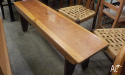 This is a vintage solid wooden bench seat/stool/pew in